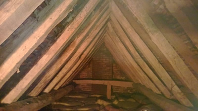 Woodworm Poole causing damage to this16th century cottage roof in Poole